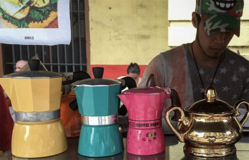 Kaizen – Man tending to  outdoor coffee shop