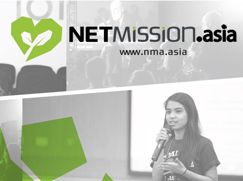Photo: NetMission Ambassador placing sticky notes on whiteboard