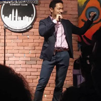 Image: Comedian performing at comedy club