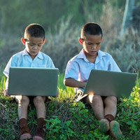 Image: 2 South East Asian boys on laptop